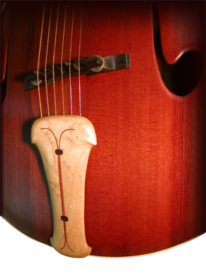 Maple tailpiece on a redwood archtop guitar