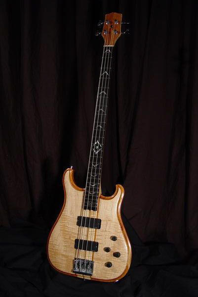 front view of michael mccarten's double cutaway electric bass model