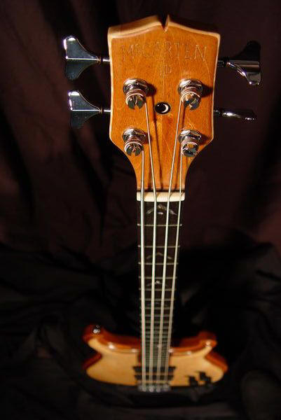 front top down view of michael mccarten's double cutaway electric bass model